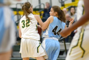 Freshman Caroline Coleman struggles for the ball with a SMS player. Photo by Luke Hoffman