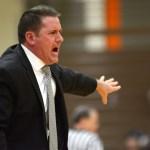 Boys varsity basketball coach Shawn Hair coaches his team. Photo by Luke Hoffman