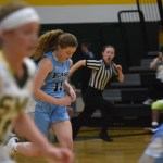 Junior Emma Eberhart sprints to guard her side of the court. Photo by Morgan Plunkett