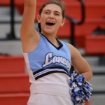During the game, junior Lucy Crum cheers for the basketball team. Photo by Reilly Moreland