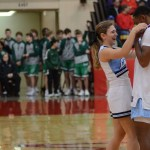 After the game, junior Lucy Crum puts a metal around senior Deonte Carroll's neck. Photo by Reilly Moreland