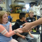 A Pawnee student is given a tarantula to hold. Photo by Ty Browning