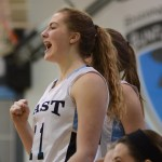 Junior Emma Eberhart cheers as East scores a point. Photo by Kathleen Deedy