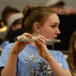 Freshman Kyla Herrick plays flute during a time out. Photo by Kathleen Deedy