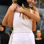 Senior Anna McClelland hugs junior Gracie Kost to honor Anna for cheer senior night. Photo by Katherine Odell