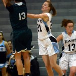 Senior Sofia Stechschulte jumps up to block a shot. Photo by Kate Nixon
