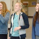 Freshmen, Lily Billingsley, Maisie Sheets, and Rose Kanaley stand back to take a look at the fairy lights they put up. Photo by Luke Hoffman