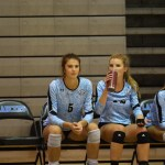 Sophomore Sarah Bingham and junior Katie Aliber watch their teammates play in the second match.  Photo by Catherine Esrey