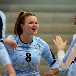 Senior Andie McConnell congratulates her teammates after winning a point. Photo by Megan Biles