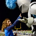 A young girl from the cheer clinic talks to the Lancer during the game.  Photo by Evelyn Roesner