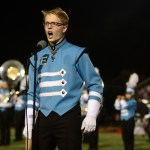 Senior Becker Truster sings during the halftime show.  Photo by Evelyn Roesner