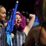 Sophomore Claire Baker laughs with her fellow Lancer Dancers before their halftime performance. Photo by Julia Percy