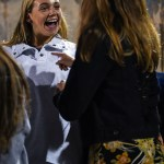 East alumni Tinka McCray and Toni Englund talk on the sideline before Englund crows the 2018 homecoming attendants, King, and Queen. Englund was the 2017 Homecoming Queen and came back from The University of Kansas to present the crowning. Photo by Lucy Morantz