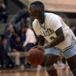 Junior Tony Friend dribbles down the court to advance toward the basket. Photo by Trevor Paulus