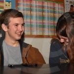 Juniors Leo Byer and Emery Uhlig laugh during one of the songs. Photo by Megan Stopperan