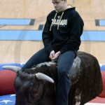 Sophomore Andrew Fey struggles to stay on the bull. Photo by Julia Percy