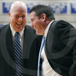 Varsity Basketball Head Coach Shawn Hair greets Rockhurst head coach Peter Campbell moments before the game begins. Photo by Luke Hoffman