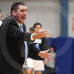 Varsity basketball Head Coach Shawn Hair is uspet after an unfavorable call by a referee. Photo by Luke Hoffman