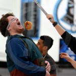 While competing in the bird box challenge, senior Johnny Loony tries to eat a doughnut. Photo by Trevor Paulus