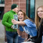 After asking her sister, sophomore Reese Meyer, what number ticket she got, senior Tatum Meyer laughs at her from the front of the line. Photo by Lucy Morantz