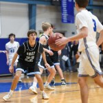 Junior Jack Slaughter pressures a Rockhurst player from outside the arc in the fourth quarter. Photo by Lucy Morantz