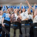 Seniors Gia Hense, Hannah Goettsch, Meg Thoma, Emily Fey, Liddy Stallard, Peyton Barbeau, and Meredith Norden lead the student section from the front row. Photo by Lucy Morantz