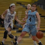 Sophomore Caroline Coleman dribbles down the court looking for a teammate to pass to. Photo by Noelle Griffin
