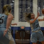 Sophomore Hanna Robinett passes to her teamate during the third quarter. Photo by Noelle Griffin