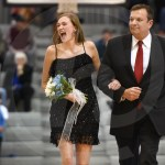 Senior sweetheart candidate Maeve McKinney is escorted by her father and former SM East principal Dr. John McKinney during the halftime ceremony. Photo by Luke Hoffman