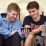 Freshman Gavin McLiney and senior Pete Stanton watch a video on McLiney's phone during a 15-minute break between events seven and eight. Photo by Luke Hoffman