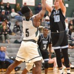 During the second quarter of the game, senior Andy Maddox scores a basket. Photo by Luke Hoffman