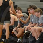 Sophomore Dominic Reynolds, sophomore Joseph Dalton, freshman Max Franklin, freshman Charlie Kallemeier, and sophomore Max Smiley high five sophomore Jerald Young after his first match of the tournament. Photo by Taylor Keal