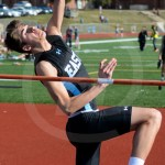 Senior Hale Reimer places himself in a stance to get the most height out of his high jump. Photo by Megan Biles