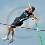 Senior Austin Eckenwiler clears the bar during the pole vault event. Photo by Ally Griffith