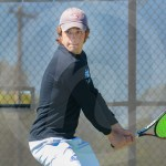 Senior Hayden Leatherwood focuses on the ball while preparing to swing his racket. Photo by Annakate Dilks