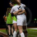 Juniors Cate Nearmyer and Maggie Schutt embrace after the Lancers take a 3-1 lead against the Eagles. Photo by Dakota Zugelder