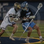 Senior Griffin Fries gets shoved by his defender when he attempts to go for a ground ball. Photo by Noelle Griffin