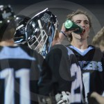 Sophomore Cade Eldred takes a sip of his water during a timeout. Photo by Noelle Griffin