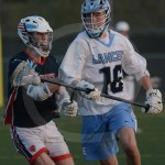 Sophomore Jacob Johnson gets the ball on defense, then takes it up the field. Photo by Noelle Griffin