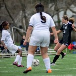 Freshman defender Allison Talge goes to kick the ball away from her opponent. Photo by Evelyn Roesner