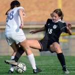 Freshman Allison Talge tries to steal the ball from her opponent. Photo by Evelyn Roesner