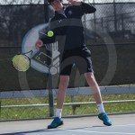 Sophomore Calvin Cattaneo hits a forehand. Photo by Megan Stopperan