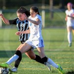 Senior Emily Cooper struggles to gain control of the ball. Photo by Megan Stopperan