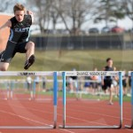 Sophomore Tyler Debey competes in the 300 meter hurdle event. Photo by Julia Percy