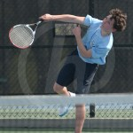 Sophomore Andrew Wegner serves the ball to the other side of the court. Photo by Reilly Moreland