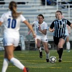 Junior Karoline Nelson focuses while dribbling the ball past her opponent. Photo by Kate Nixon