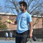 Sophomore Sonny Vesali asks his opponents if they would like the two tennis balls in his hand as they switch sides on the court. Photo by Taylor Keal