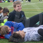 Junior Michael Venneman talks and relaxes with his friends before the meet begins. Photo by Elle Karras
