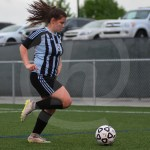 Senior Emily Cooper dribbles down the field. Photo by Megan Stopperan.