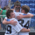 Junior Phillip Clemente, senior Henry Mahaffy, and senior Will Mohr embrace each other after the game. Photo by Noelle Griffin